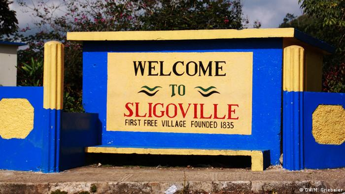 A sign reading Welcome to Sligoville, first free village founded 1835