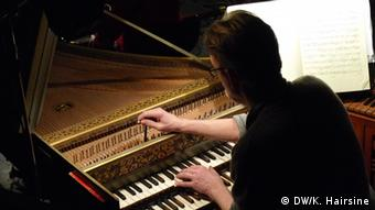 A member of the Lautten Companey tunes a harpsichord during a rehersal. (Photo: Kate Hairsine)