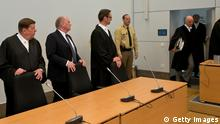 MUNICH, GERMANY - MARCH 11: President of Bayern Muenchen Ulrich Hoeness (C) and his lawyers Markus Gotzens (R) and Hanns W. Feigen (L) stand during Hoeness' trial for tax evasion in the courtroom of the Higher Regional Court on March 11, 2014 in Munich, Germany. Hoeness is accused of tax evasion by siphoning more than 33million Euros into a Swiss bank account. (Photo by Joerg Koch-Pool/Getty Images)