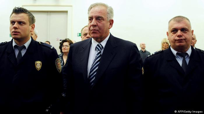 Former Croatian Prime Minister Ivo Sanader hears his verdict in court in Zagreb on March 11, 2014