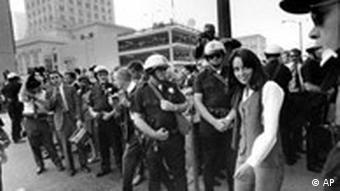 Singer Joan Baez being arrested during a sit-in in 1967, protesting the Vietnam War draft