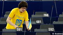Latvia's Member of the European Parliament Sandra Kalniete wears a shirt with the word Ukraine as she arrives in the plenary room of the European Parliament ahead of a debate on the invasion of Ukraine by Russia in Strasbourg, March 12, 2014. REUTERS/Vincent Kessler (FRANCE - Tags: POLITICS)