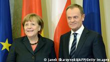Polish Prime Minister Donald Tusk (R) and German Chancellor Angela Merkel gesture at the begining of their meeting on March12, 2014 in Warsaw. AFP PHOTO/JANEK SKARZYNSKI (Photo credit should read JANEK SKARZYNSKI/AFP/Getty Images)