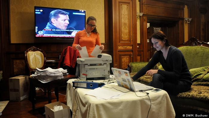 Journalists scanning documents