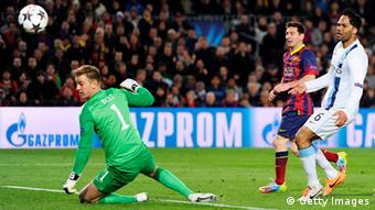 Lionel Messi of Barcelona flicks the ball past goalkeeper Joe Hart of Manchester City to score the opening goal during the UEFA Champions League Round of 16, second leg match between FC Barcelona and Manchester City. Photo: Getty