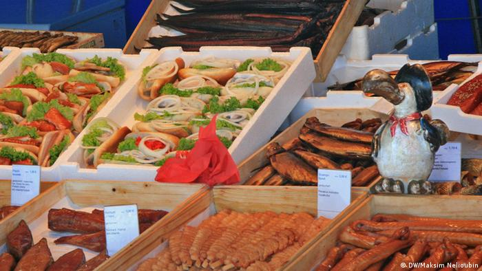 Display of fish rolls at a market stand in Wismar