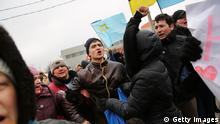 SIMFEROPOL, UKRAINE - MARCH 10: Supporters of Ukraine yell at pro- Russian protesters during a rally in support of the keeping Crimea a part of the Ukraine on March 10, 2014 in Simferopol, Ukraine. As the standoff between the Russian military and Ukrainian forces continues in Ukraine's Crimean peninsula, world leaders are pushing for a diplomatic solution to the escalating situation. Crimean citizens will vote in a referendum on March 16, on whether to become part of the Russian federation. (Photo by Spencer Platt/Getty Images)