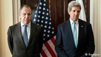 Kerry and Lavrov pose for a photograph Photo: REUTERS/Brendan Smialowski/pool