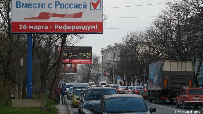 A poster in Simferopol bearing the message, Together with Russia. Referendum on March 16.