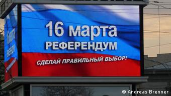 A screen mounted on a building in Simferopol displaying a pro-Russia message