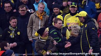 Head coach Juergen Klopp of Dortmund discusses with fans during the Bundesliga match between Borussia Dortmund and Borussia Moenchengladbach at Signal Iduna Park on March 15, 2014 in Dortmund, Germany. (Photo by Lars Baron/Bongarts/Getty Images)