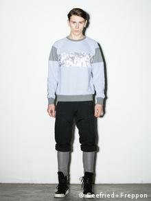 Model presents a sweatshirt from Berlin label Kinder & Tank, Copyright: Seefried+Freppon