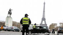 Police officers control cars in front of the Eiffel Tower in Paris, on March 17, 2014 as Paris resorted to drastic measures to curb soaring pollution levels by forcing all cars with number plates ending in even numbers off the road for the first time in two decades. Around 700 police officers were deployed to man 60 checkpoints around the French capital to ensure that only cars with number plates ending in odd numbers were out on the streets. AFP PHOTO/FRANCOIS GUILLOT (Photo credit should read FRANCOIS GUILLOT/AFP/Getty Images)