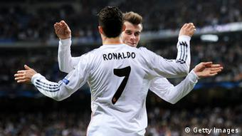 UEFA Champions League Real Madrid - FC Schalke 04 - MADRID, SPAIN - MARCH 18: Cristiano Ronaldo of Real Madrid celebrates with teammate Gareth Bale after scoring his team's second goal during the UEFA Champions League Round of 16, second leg match between Real Madrid and FC Schalke 04 at Estadio Santiago Bernabeu on March 18, 2014 in Madrid, Spain. (Photo by Denis Doyle/Getty Images)