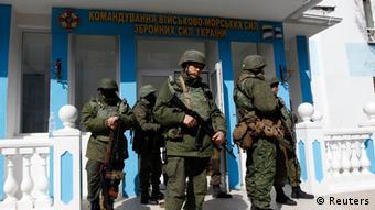armed men standing guard