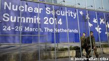 epa04128965 Two soldiers pass the World Forum building, where the Nuclear Security Summit 2014 is to be held in The Hague, The Netherlands, 16 March 2014. On 24 and 25 March the Netherlands will welcome 58 world leaders, 5,000 delegates and 3,000 journalists to the Nuclear Security Summit (NSS) in The Hague, the largest gathering of its kind ever held in this country. EPA/BART MAAT pixel