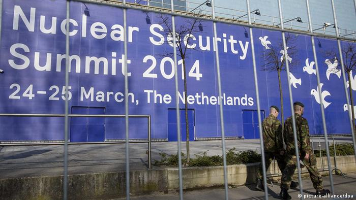 Two soldiers pass the World Forum building, where the Nuclear Security Summit 2014 is to be held in The Hague, The Netherlands, 16 March 2014. On 24 and 25 March the Netherlands will welcome 58 world leaders, 5,000 delegates and 3,000 journalists to the Nuclear Security Summit (NSS) in The Hague, the largest gathering of its kind ever held in this country.
