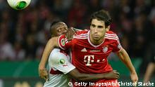 Bayern Munich's Spain midfielder Javi Martinez (R) and Suttgart's Guiana's midfielder Ibrahima Traore (L) challenge for the ball during the final football match of the German Cup (DFB - Pokal) FC Bayern Munich vs VfB Stuttgart on June 1, 2013 at the Olympic Stadium in Berlin. AFP PHOTO / CHRISTOF STACHE RESTRICTIONS / EMBARGO - DFL LIMITS THE USE OF IMAGES ON THE INTERNET TO 15 PICTURES (NO VIDEO-LIKE SEQUENCES) DURING THE MATCH AND PROHIBITS MOBILE (MMS) USE DURING AND FOR FURTHER TWO HOURS AFTER THE MATCH. FOR MORE INFORMATION CONTACT DFL (Photo credit should read CHRISTOF STACHE/AFP/Getty Images)