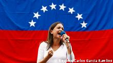 Opposition deputy Maria Corina Machado speaks during a rally against Nicolas Maduro's government in Caracas March 3, 2014. Jailed Venezuelan opposition leader Leopoldo Lopez urged sympathizers on Monday to maintain street protests against President Nicolas Maduro as the country's foreign minister prepared to meet the United Nations Secretary General. REUTERS/Carlos Garcia Rawlins (VENEZUELA - Tags: POLITICS CIVIL UNREST)