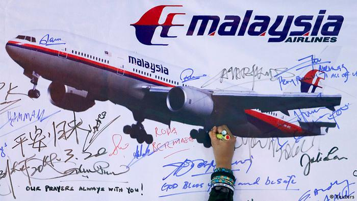 Well wishes for flight MH370 written on a picture of the plane.