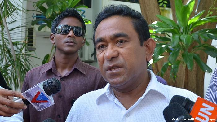 Maldives President Abdulla Yameen Abdul Gayoom talks to journalists on voting day for the parliamentary elections in Male on March 22, 2014. AFP PHOTO/HAVEERU HAVEERU/AFP/Getty Images