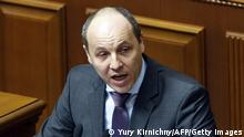 Head of the Ukraine's National Security and Defence Council Andriy Parubiy delivers a speech during a parliamentary session on March 17, 2014, in Kiev. Ukrainian troops will remain in Crimea, the country's defence minister said that day even as media reported the separatist peninsula planned to disband Ukrainian units there. The day before Crimeans voted overwhelmingly to join former political master Russia as tensions soared in the east of the splintered ex-Soviet nation amid the worst East-West crisis since the Cold War. AFP PHOTO/ YURY KIRNICHNY (Photo credit should read YURY KIRNICHNY/AFP/Getty Images)
