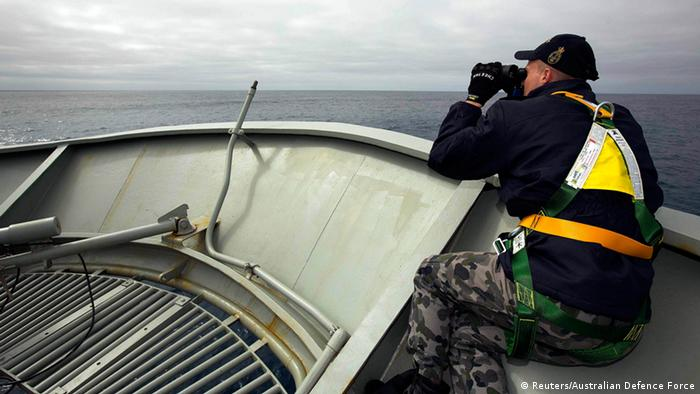 Able Seaman Kurt Jackson keeps watch on the forecastle of the Australian Navy ship, the HMAS Success, in a search area for missing Malaysian Airlines Flight MH370 in this picture released by the Australian Defence Force March 24, 2014. A Chinese military aircraft searching for the missing aircraft spotted several suspicious floating objects on Monday in remote seas off Australia, increasing the likelihood that the wreckage of the plane may soon be found. REUTERS/Australian Defence Force/Handout via Reuters