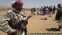 Shiite rebels, known as Huthis or Ansarullah, stand on a road in Omran province north of Yemen on March 23, 2014. Twelve people were killed in clashes between Yemeni forces and Shiite rebels on the outskirts of the northern city of Amran, a local official and tribal sources said. AFP PHOTO/GAMAL NOMAN (Photo credit should read GAMAL NOMAN/AFP/Getty Images)
