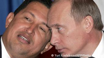 Venezuelan President Hugo Chavez leans in to speak with his Russian counterpart, Vladimir Putin, during a meeting in Moscow in 2004 (Yuri Kadobnov/AFP/Getty Images)