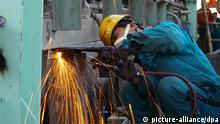 --FILE--A migrant worker welds a steel product at a factory in Rizhao city, east Chinas Shandong province, 26 October 2013. The average monthly wage for Chinas 166 million migrant workers rose 13.9 percent last year, said the Ministry of Human Resources and Social Security on Thursday (20 February 2014). Migrant workers, defined as those who have worked away from home for more than six months, earned an average of 2,609 yuan (429.2 U.S. dollars) per month, said the ministry. China had a total of 269 million farmers working in non-agricultural sectors by the end of 2013, up 2.4 percent year on year, according to the ministry.