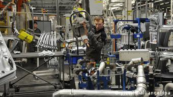 A worker operates machinery in a Volkswagen factory in Russia