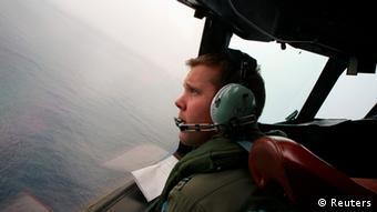 Co-Pilot, Flying Officer Marc Smith, turns his Royal Australian Air Force (RAAF) AP-3C Orion aircraft at low level in bad weather whilst searching for the missing Malaysian Airlines Flight MH370 over the southern Indian Ocean March 24, 2014.