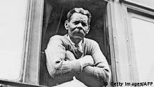 GORKY, RUSSIA: Russian-Soviet writer and playwright Maxim Gorky peers from a window of a sleeping-car probably in 1929 in Gorky. Gorky (1868-1936) held a variety of menial posts before becoming a writer, producing several romantic short stories, than social novels and plays, notably the drama 'The Lower Depths' (1902). He was the first president of the Soviet Writers Union and a supporter of Stalinism. He died in mysterious circumstances, and may have been the victim of an anti-Soviet plot. (Photo credit should read AFP/Getty Images)