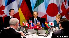 U.S. President Barack Obama (C) participates in a G7 leaders meeting during the Nuclear Security Summit in The Hague March 24, 2014. At the table are the President of the European Council Herman Van Rompuy, British Prime Minister David Cameron, Obama, German Chancellor Angela Merkel and President of the European Commission Jose Manuel Barroso. (L-R, clockwise). REUTERS/Jerry Lampen/Pool (NETHERLANDS - Tags: POLITICS)