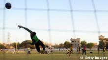 TO GO WITH FBL-PAK-CHILDREN-POVERTY FOCUS BY SHAHID HASHMI This photograph taken on March 17, 2014, shows Pakistani street children taking part in a football training camp in Karachi for the forthcoming Street Child World Cup which starts in Brazil next week. Sixteen-year-old drug addict Mohammad Salman thought he was destined to live his life on the mean streets of Karachi, begging for survival and with no prospects for a better future. That all changed one day when he was spotted by the non-profit Azad Foundation, which rehabilitates street children in the sprawling Pakistani metropolis of 19 million. The first edition was held in South Africa ahead of the 2010 World Cup and featured Brazil, South Africa, Nicaragua, Ukraine, India, the Philippines, Tanzania and a team from Manchester, England. India won the inaugural event, which proved so successful that it was decided to hold it ahead of every football World Cup. AFP PHOTO/Asif HASSAN (Photo credit should read ASIF HASSAN/AFP/Getty Images)
