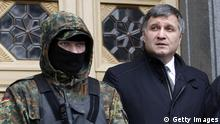 Arsen Avakov (R), Ukraine's newly appointed Interior minister, leaves a Parliament session in Kiev on February 22, 2014. Avakov, a close ally of Ukraine's jailed opposition icon Yulia Tymoshenko was named interim interior minister on February 22, replacing a man blamed for ordering police to open fire on protesters. He was elected to the post during an animated parliament session shortly after Tymoshenko's right-hand man was voted in as parliament speaker, as the regime of embattled president Viktor Yanukovych appeared close to collapse. AFP PHOTO/ YURY KIRNICHNY (Photo credit should read YURY KIRNICHNY/AFP/Getty Images)