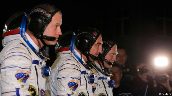 Members of the International Space Station prior their launch at the Baikonur cosmodrome March 26, 2014. REUTERS/Maxim Shemetov