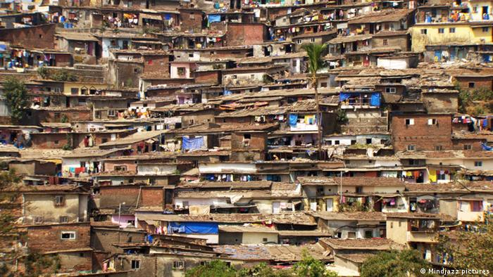 Shanty huts stretch back into the distance in this huge slum - a scene from the film Population Boom Photo: Mindjazz pictures