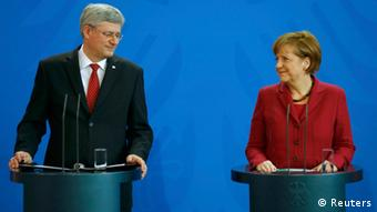 Stephen Harper and Angela Merkel at their joint press conference in Berlin (Photo: REUTERS/Kai Pfaffenbach)