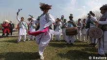 Afghan artists perform the traditional attan dance during the international Nawroz celebrations (Persian New Year celebrations) in Kabul March 27, 2014. REUTERS/Omar Sobhani (AFGHANISTAN - Tags: ANNIVERSARY SOCIETY)
