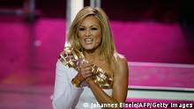 German singer Helene Fischer performs during the 2014 Echo Music Awards in Berlin, on March 27, 2014. The German music awards are granted every year by the German Phono academy with prizes in 27 categories. AFP PHOTO / POOL / JOHANNES EISELE (Photo credit should read JOHANNES EISELE/AFP/Getty Images)