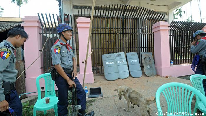 Myanmar police outside aird organization offices