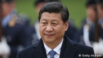Chinese President Xi Jinping reviews a guard of honour with German President Joachim Gauck (not pictured) upon President Xi Jinping's arrival at Schloss Bellevue on March 28, 2014 in Berlin, Germany.