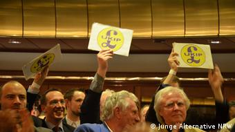 UKIP supporters with signs in the Cologne auditorium