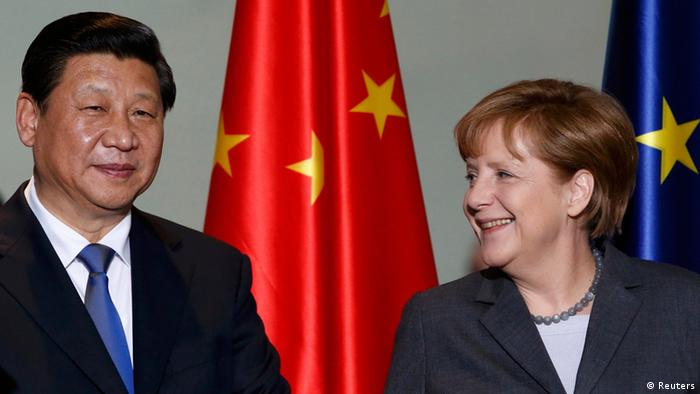 German Chancellor Angela Merkel and China's President Xi Jinping arrive for an agreement signing at the Chancellery in Berlin March 28, 2014.