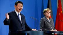 German Chancellor Angela Merkel and China's President Xi Jinping address a joint news conference after an agreement signing, at the Chancellery in Berlin March 28, 2014. REUTERS/Fabrizio Bensch (GERMANY - Tags: POLITICS)