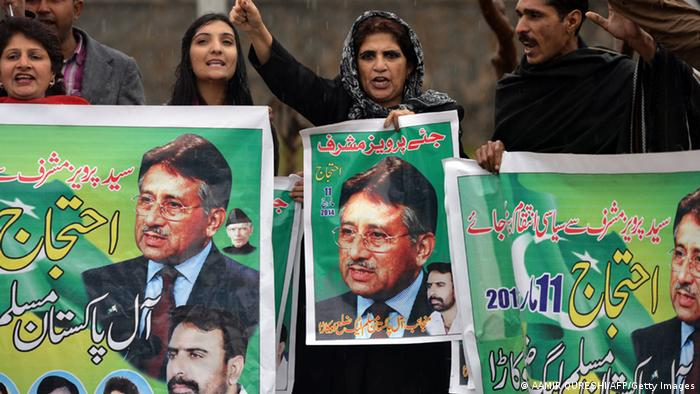 Pakistani supporter of former military ruler Pervez Musharraf shout slogans as they hold banners with images of Musharraf outside a special court set up to try Musharraf during a hearing in Islamabad on March 11, 2014 (Photo: AAMIR QURESHI/AFP/Getty Images)