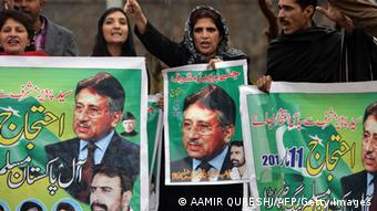 Pakistani supporters of former military ruler Pervez Musharraf shout slogans as they hold banners with images of Musharraf outside a special court set up to try Musharraf during a hearing in Islamabad on March 11, 2014 (Photo: AAMIR QURESHI/AFP/Getty Images)