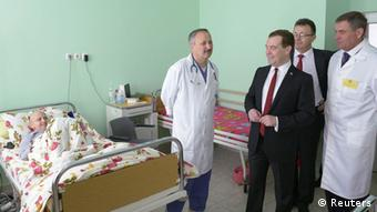Russia's Prime Minister Dmitry Medvedev (2nd R, front) visits a children's hospital in the Crimean city of Simferopol, March 31, 2014. (Image obtained via Reuters, from third party.)