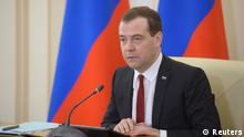 Russia's Prime Minister Dmitry Medvedev chairs a government meeting in the Crimean city of Simferopol, March 31, 2014. Russia will make Crimea a special economic zone offering tax breaks and reduced bureaucracy to attract investors, Prime Minister Dmitry Medvedev said on Monday. REUTERS/RIA Novosti/Alexander Astafyev/Pool (UKRAINE - Tags: POLITICS BUSINESS) ATTENTION EDITORS - THIS IMAGE HAS BEEN SUPPLIED BY A THIRD PARTY. IT IS DISTRIBUTED, EXACTLY AS RECEIVED BY REUTERS, AS A SERVICE TO CLIENTS